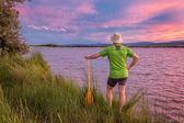 Canoe paddler and sunset sky — Stock Photo