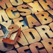 Question mark and alphabet in wood type — Stock Photo #80809432