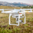 Постер, плакат: Phantom drone flying with camera