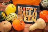 Happy Halloween on tablet with squash — Stock Photo