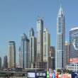 Road and modern skyscrapers in Dubai — Stock Photo #68562039