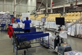 Working people in logistics center — Stock Photo
