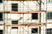 Construction of new house with scaffolding — Stockfoto
