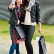 Two attractive girls making a selfie after shopping — Stock Photo #69179573