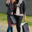 Two attractive girls making a selfie after shopping — Stock Photo #69552945