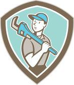 Loodgieter houden monkey wrench schild cartoon — Stockvector