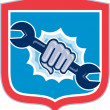 Mechanic Hand Holding Spanner Shield Punching — Stock Vector #52632359