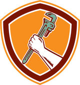 Hand Holding Adjustable Wrench Shield Woodcut — Stock Vector