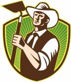 Organic Farmer Holding Grab Hoe Shield — Wektor stockowy