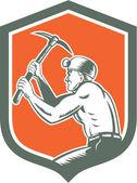 Mijnwerker met pick bijl schild retro — Stockvector