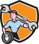 Mechanic Spanner Wrench Tire Shield Cartoon — Stock Vector