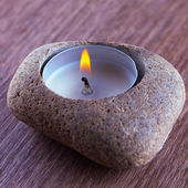 Stone and candle — Stock Photo