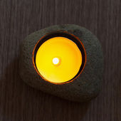 Candle in stone — Stock Photo