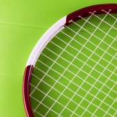 Tennis racket over synthetic surface — Stock Photo