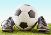 Football with shoes — Stock Photo