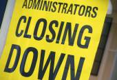 Closing down sign — Stock Photo