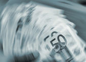 Euro currency in a spin — Stock Photo