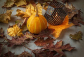 Pumpkin and candle in a candlestick — Stock Photo