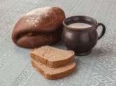 Mug with milk and rye bread — Stock Photo