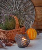 Heather on the basket next to a candle — Stock Photo