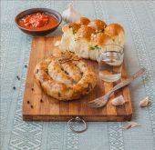 Ring homemade sausage and glass of vodka — Stock Photo