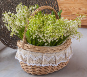 Basket with lilies of valley — ストック写真