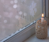 Window with burning candle — Стоковое фото