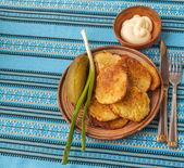 Potato flapjacks on the embroidered tablecloth — Stock Photo