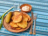 Potato flapjacks and a glass of vodka — Stock Photo
