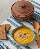 Pumpkin soup with fried onions and meat — Stock Photo