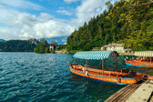 Traditional wooden boats Pletna on lake Bled — Stock Photo