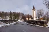 Church of Sv. John the Baptist and a bridge — Stock Photo