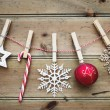 Christmas ornaments on a wooden background — Stock Photo #56738081