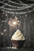 Cupcake with sparkler — Stock Photo