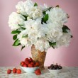 Ripe cherries and strawberries with bouquet of peonies — Stock Photo #62140819