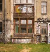 Dilapidated edifice in Art Nouveau style painted with graffitti — Stock Photo