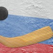 Hockey puck, hockey stick and a Russian flag — Stock Photo #69980171