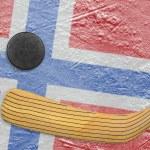 Hockey puck, hockey stick and a Norwegian flag — Stock Photo #71650309