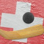 Hockey puck, hockey stick and the Swiss flag — Stock Photo #71650307