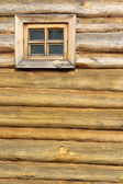 A window in a wooden wall — Stock Photo