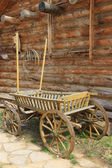 Old cart near the wall — Stock Photo