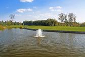 Mezhyhirya - former private residence of ex-president Yanukovich, now open to the public, Kyiv region, Ukraine. Pond on the golf field. — Stockfoto