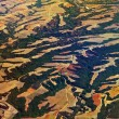 Aerial view over agricultural fields and hills in Greece — Stock Photo #59759375