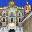 Entrance to Kiev-Pechersk Lavra monastery from Mazepa street. The walls are decorated with rich carvings and paintings — Stock Photo #62634581