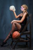 Blonde woman with skull and pumpkin — Stock Photo