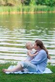 Motherhood, boy kissing his pregnant mother — Stock Photo