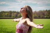 Beautiful young woman enjoying unity with nature — Stock Photo