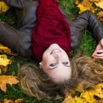Autumn woman on leafs — Stock Photo #52732443