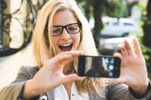 Blonde woman taking self portrait, selfie concept — Stock Photo