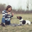 Woman having fun with her dog — Stock Photo #68921097